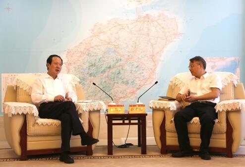 丁焰章拜会海南省人民政府副省长刘平治