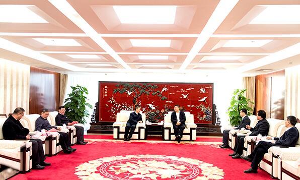 赵建国会见哈电集团董事长、党委书记斯泽夫